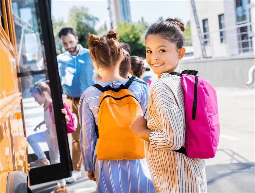 little-schoolgirl-entering-school-bus